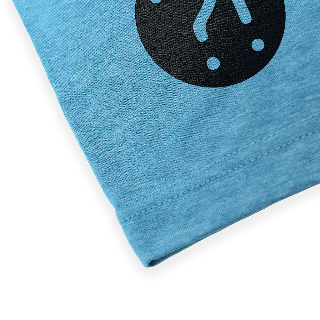 Bottom hem of Stick it Wear?! 'PICARD'S FOE' Grasscourt Tennis Graphic Tee in blue.