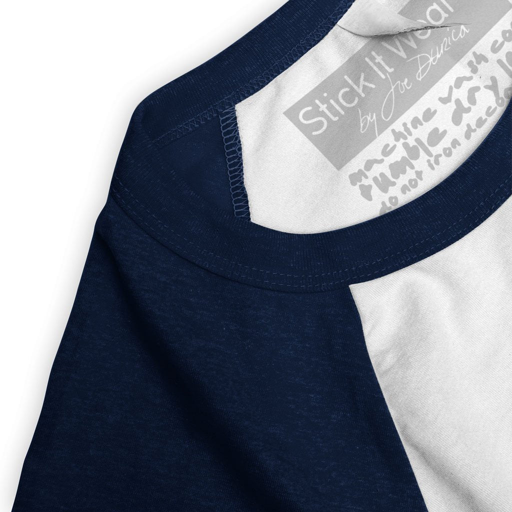 Collar of Stick it Wear?! 'ROCKET LAUNCHER' baseball practice t-shirt in white with navy sleeves.