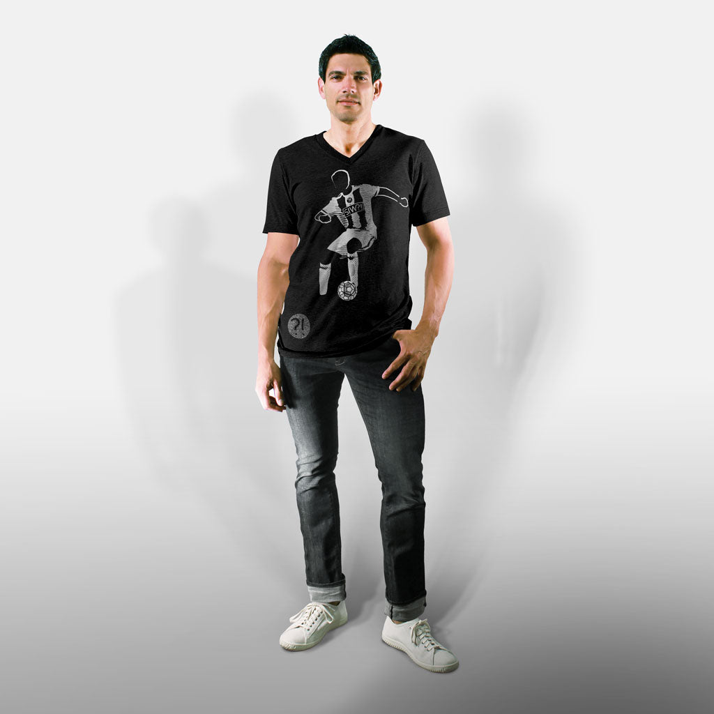Model wearing Stick it Wear?! 'SEE RONNIE STEPOVER' Soccer V-Neck in black.