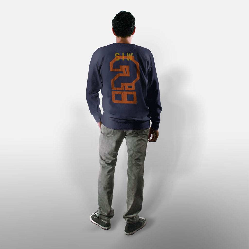 Model wearing Stick it Wear?! 'SWEET RUN' Football Front Office sweatshirt in navy.