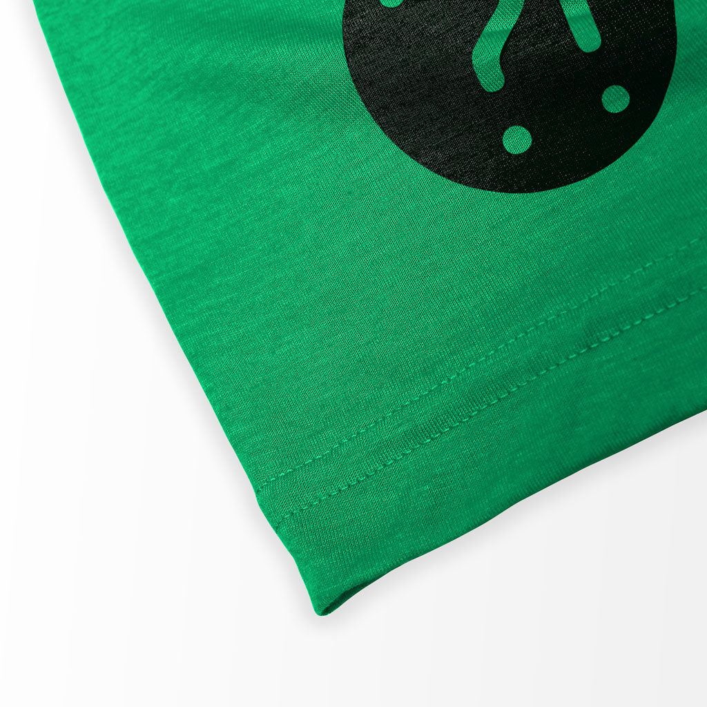 Bottom hem of Stick It Wear?! 'THE JUAN' First Serve Tennis Tee in green.
