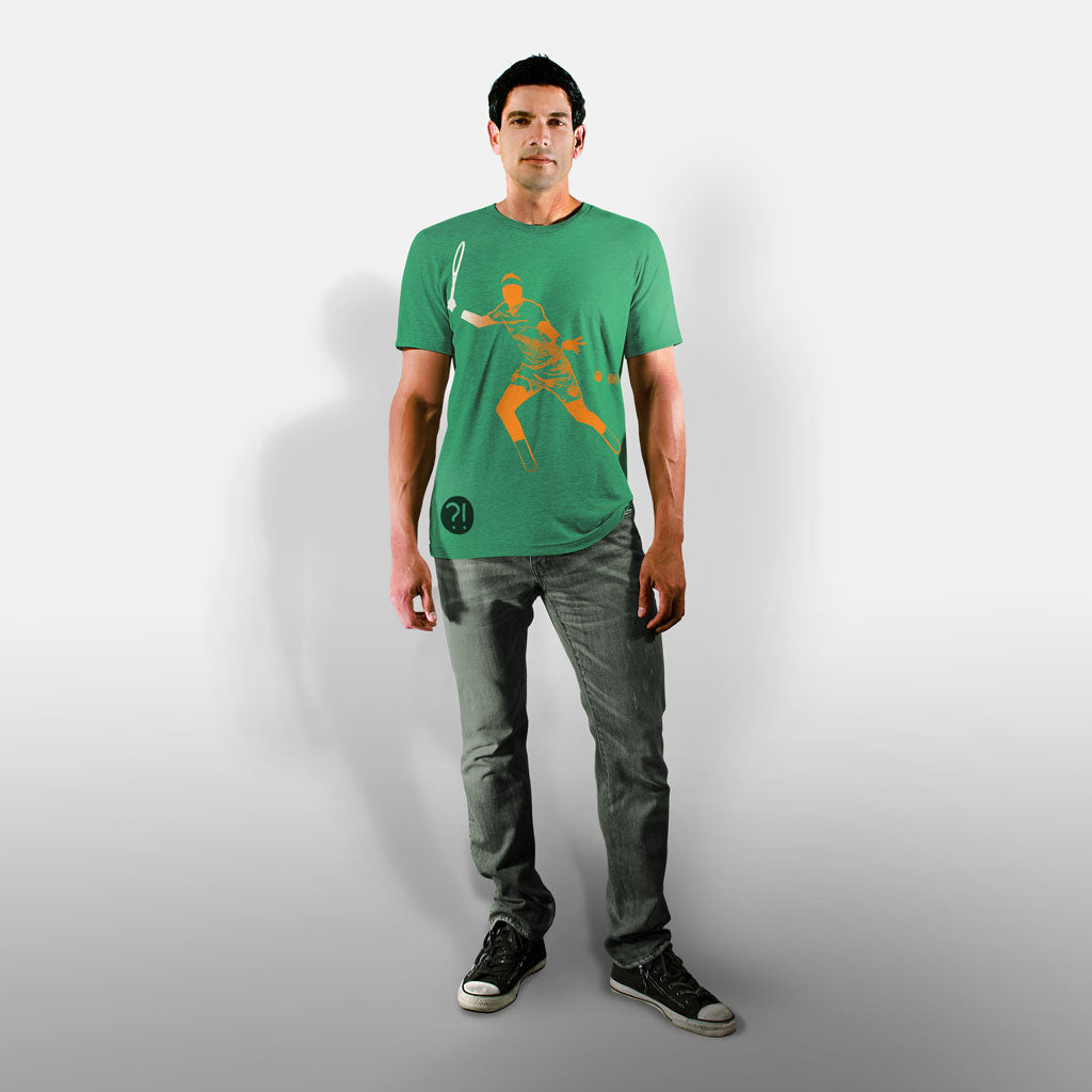 Model wearing Stick It Wear?! 'THE JUAN' First Serve Tennis Tee in green.
