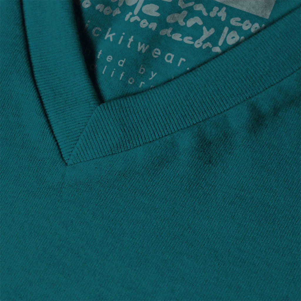 Collar of Stick It Wear?! 'TRAPPING CANNON' Soccer V-Neck t-shirt in teal.