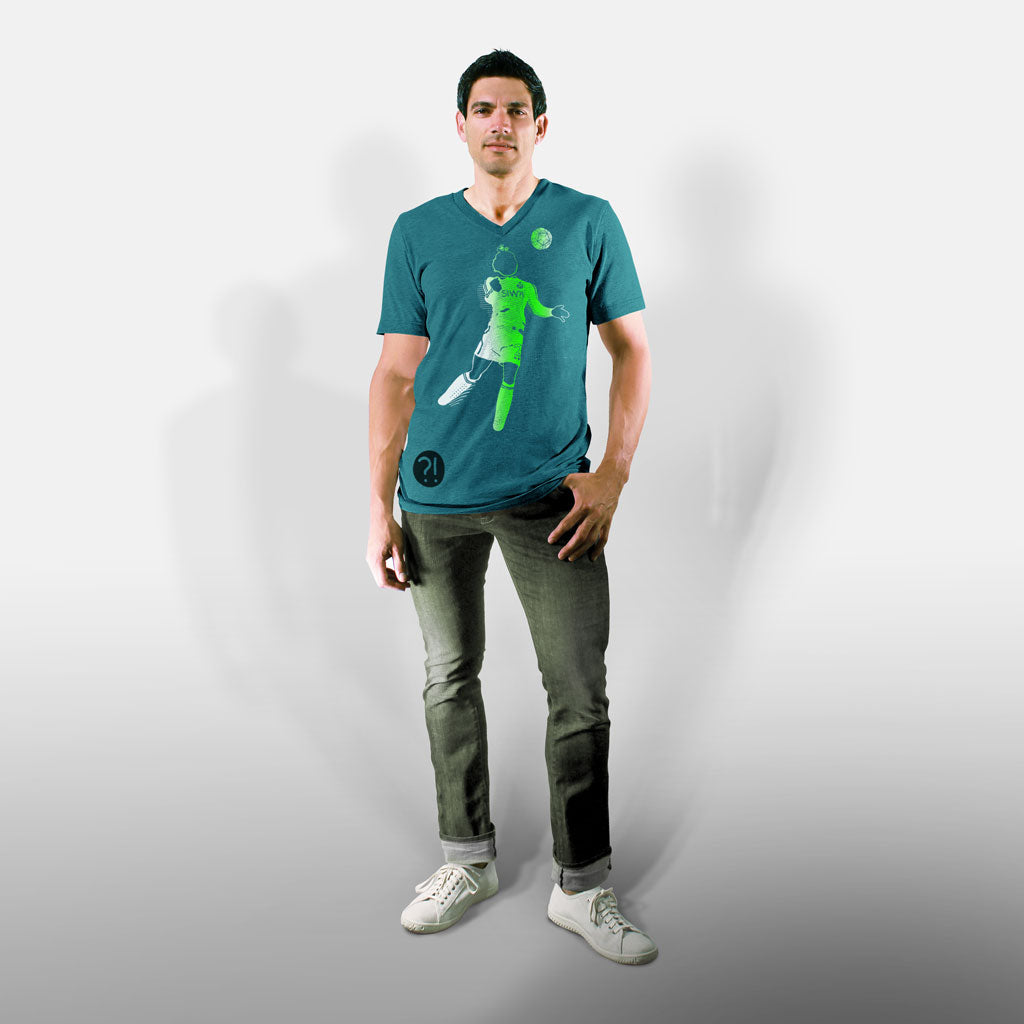 Model wearing Stick It Wear?! 'TRAPPING CANNON' Soccer V-Neck t-shirt in teal.