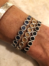 Load image into Gallery viewer, Three bracelets layered together: monocord single wrap in navy, single wrap in champagne, single wrap in black