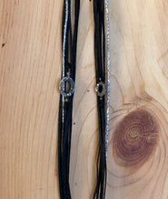 Load image into Gallery viewer, Oval, featured in black with a silver sparkly cord (left); bracelet on the right is featured in Lampsi (ena mikro)