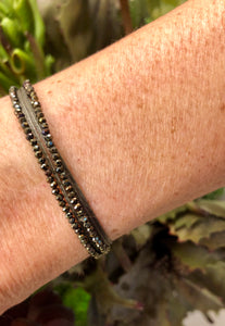 Featured in taupe with brown beads