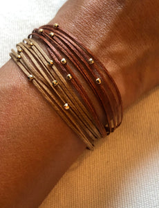 Stack two together; Polished 14k yellow gold featured in rust (top) and champagne (bottom)