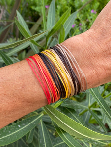 Multiple bracelets, each in its own color