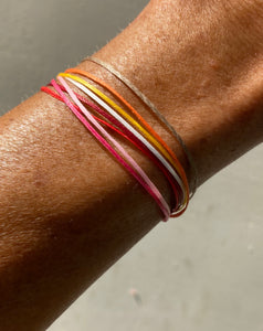 One bracelet with multiple color cords