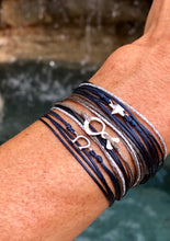 Load image into Gallery viewer, Paired together: Horseshoe in navy, Silverfish in taupe, Star in navy - all with silver sparkly cord