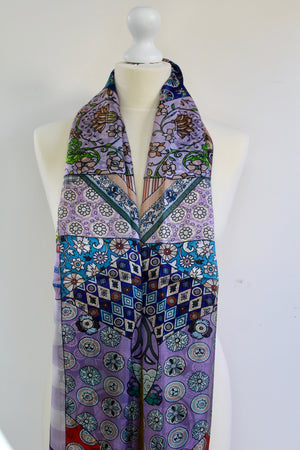 Purples , mustard , blues all together in this beautiful oriental patterned stole.   Make your evening magical . Wear with silk wide pants !   100% satin silk . 180cm x 110cm