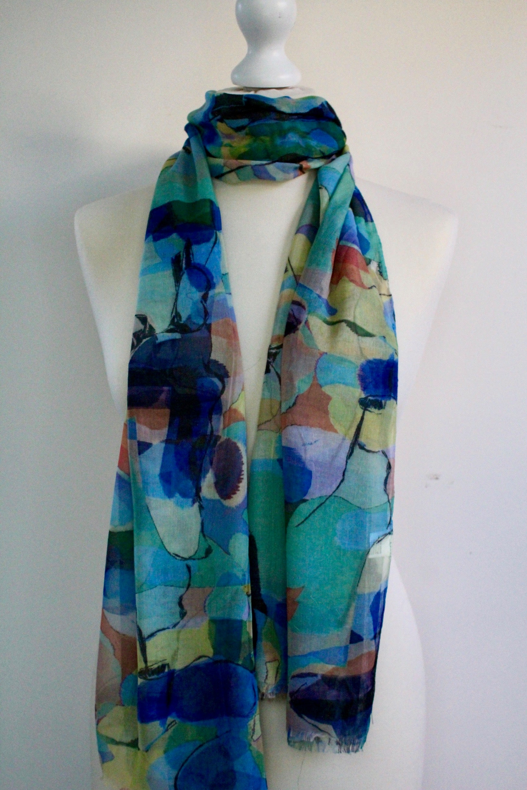 50% Cotton   50% viscose   180cm x 90cm   Feels  like silk .   Great with jeans or casual jacket