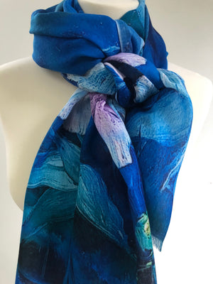 Memories of coastal Ireland provided the inspiration for this impressionistic scarf. Ginger lilies and daisies look like rich brushwork against a background of intense, stormy blue. Digitally printed on a silky soft, wrinkle-free viscose/wool blend.