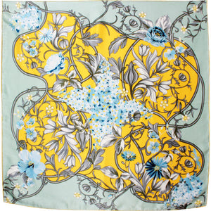 Exquisite  silk scarf with sapphire blue and sunflower yellow shades on a pale blue background . Delicate blue roses with white oriental  flower intertwined.   90cm x 90 cm   Hand rolled trim