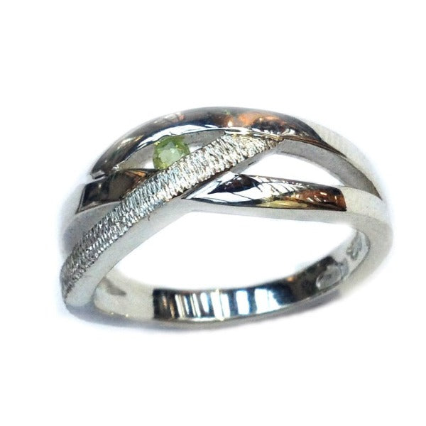 silver ring set with peridot celtic style unityring