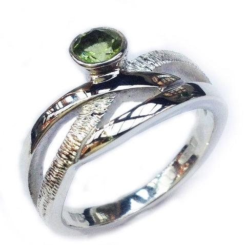 silver ring set with peridot celtic style