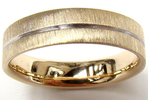 close up image of gents yellow gold wedding ring with scratch finish