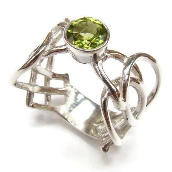 Celtic ring designed by barry doyle set with peridot