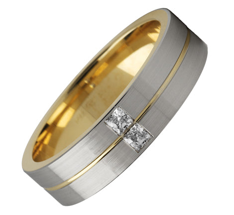 white and yellow gold ring with groove detail and princess cut diamonds