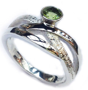 silver ring set with peridot handmade celtic