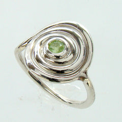 silver spiral ring with peridot