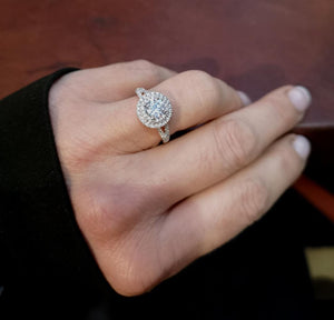 Diamond double halo white gold engagement ring on the finger