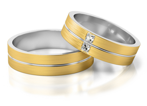 yellow and white gold wedding ring with princess cut diamonds