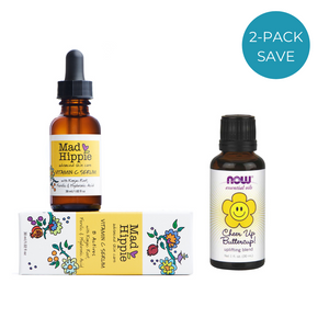 Vitamin C serum on box with essential oil bottle