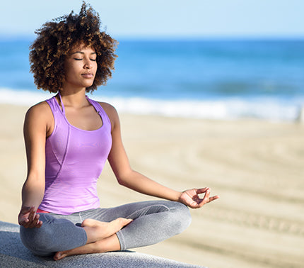 Woman finding wellness in the sunlight