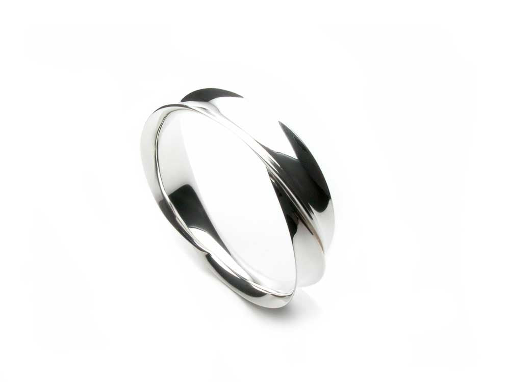 Sterling silver, concave overlapping design. $780.00