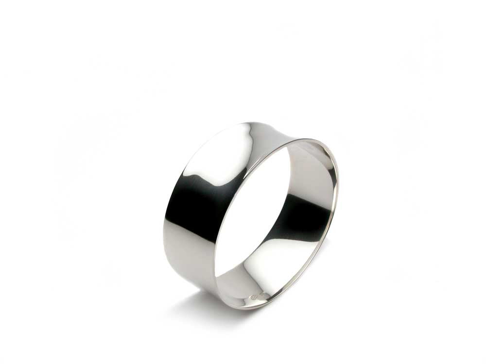 Sculptural bangle with a slight concave asymmetrical shape, 1