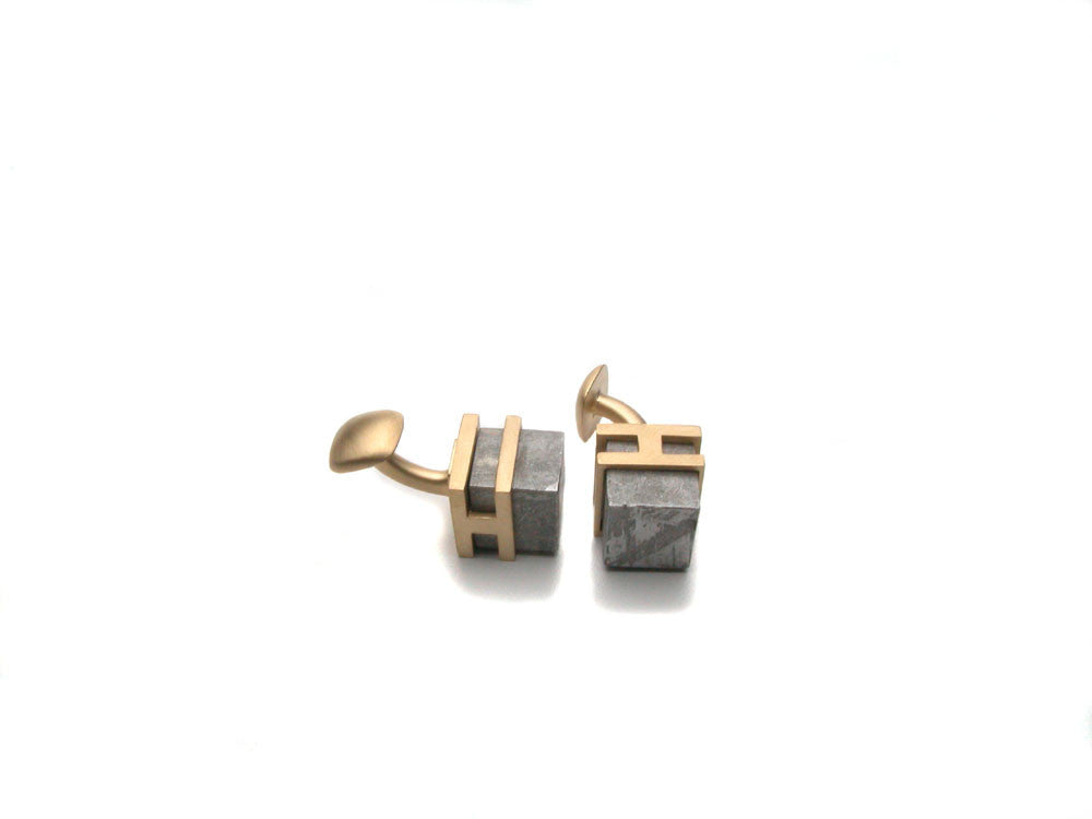 Meteorite cubes set in eighteen karat yellow gold, satin brushed. Price upon request. $0.00