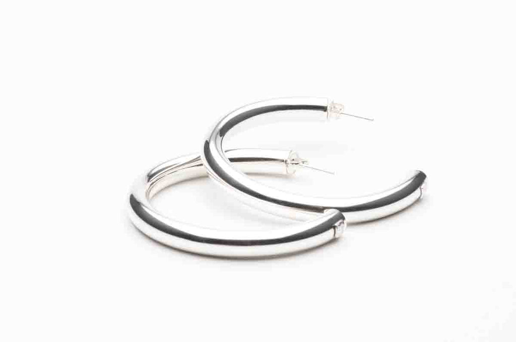 Sterling Silver hoop earrings, various sizes starting at $150. $380.00