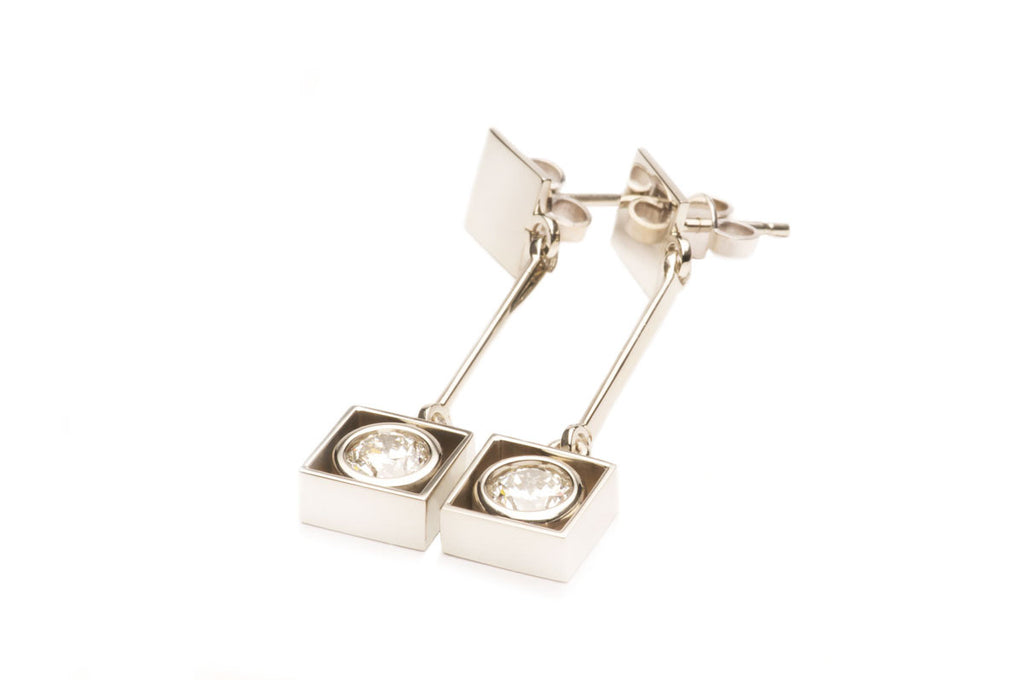 Custom made earrings in eighteen karat white gold with diamonds. Price inquiry. $0.00
