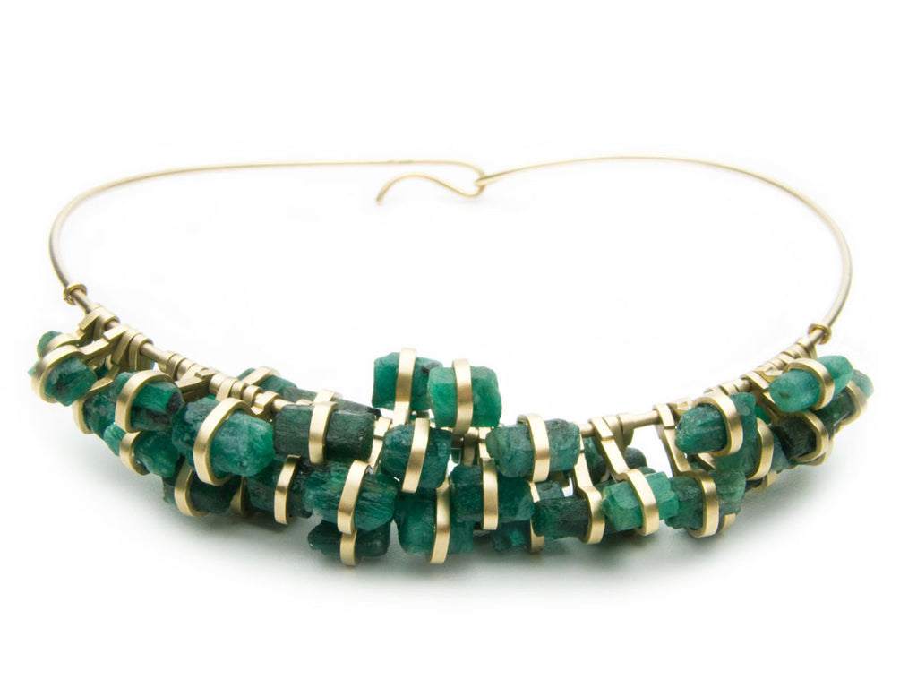 Fifty-two Emerald chunks set in eighteen karat yellow gold, suspended on a gold neck ring. Commissioned work. $0.00