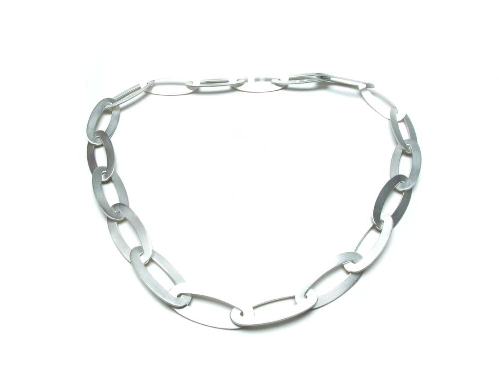 Sterling silver flat, oval links with integrated clasp. $980.00
