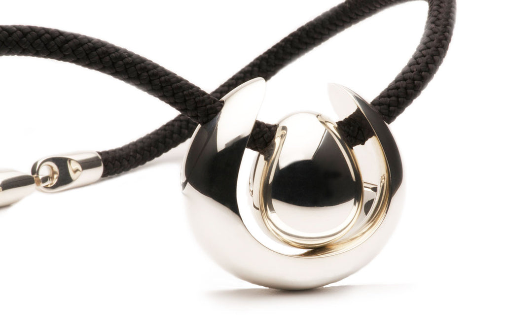 Sterling Silver pendant on a black silk cord with a tubular puzzle clasp. $1,680.00