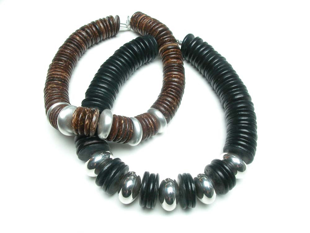 Sterling silver hand made beads and wood discs. $1,650.00
