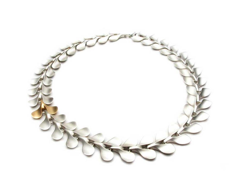 THE LEAF necklace in sterling silver with one element in eighteen karat gold. $2,670.00