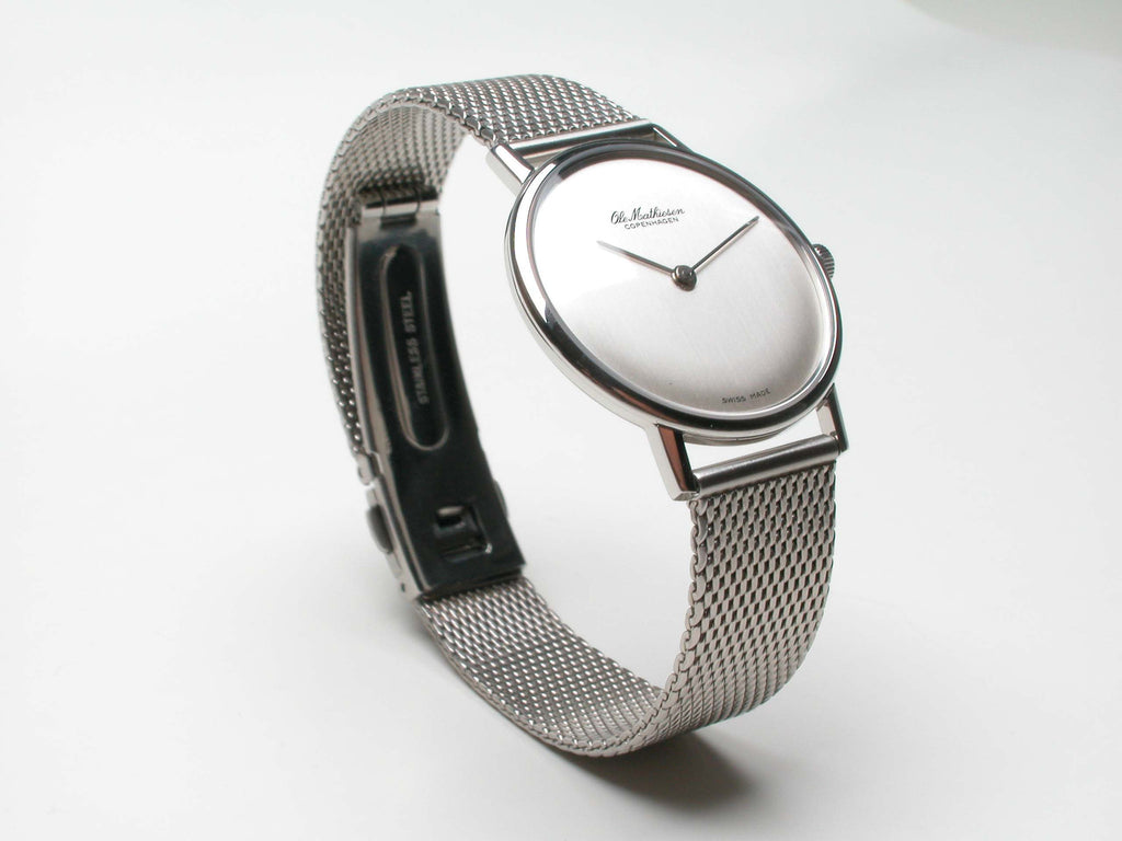 Monochromatic look in stainless steel. Swiss made, quartz movement. Stainless steel mesh bracelet. Price inquiry. For more info: olemathiesen.dk $1,350.00