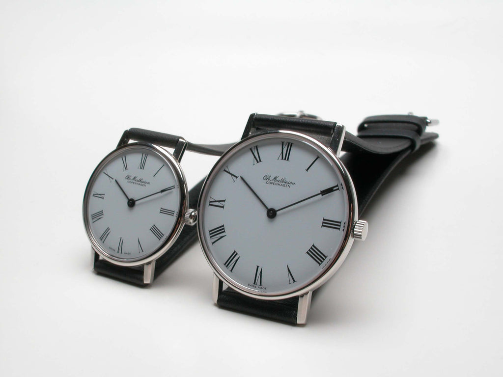Original 1962 design by Ole Mathiesen, Swiss made, 7 jewels, quartz movement, leather strap. Available in 28, 33, 35mm. Stainless steel bracelet also available. For more info: olemathiesen.dk   $1,290.00