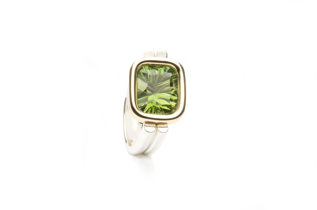 Custom made sterling silver ring, eighteen karat gold setting, 11 x 9 mm green Tourmaline, Optix emerald cut. Price inquiry.   $0.00