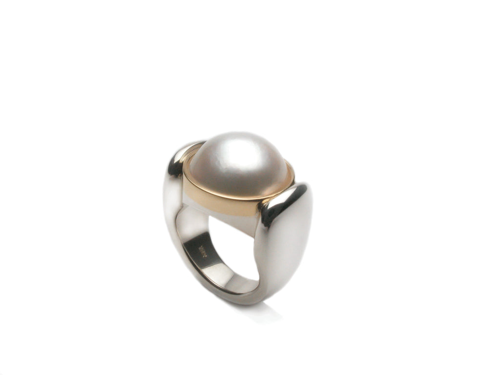 White Mabe pearl set in eighteen karat gold and sterling silver. Pearl size 12 - 15 mm. From $ 1990.00 $1,990.00