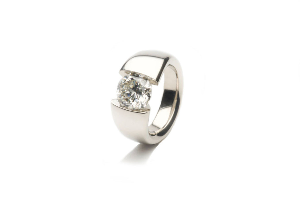 Eighteen karat white gold tension-ring holding a natural 3.5 carats diamond. Price inquiry. $0.00