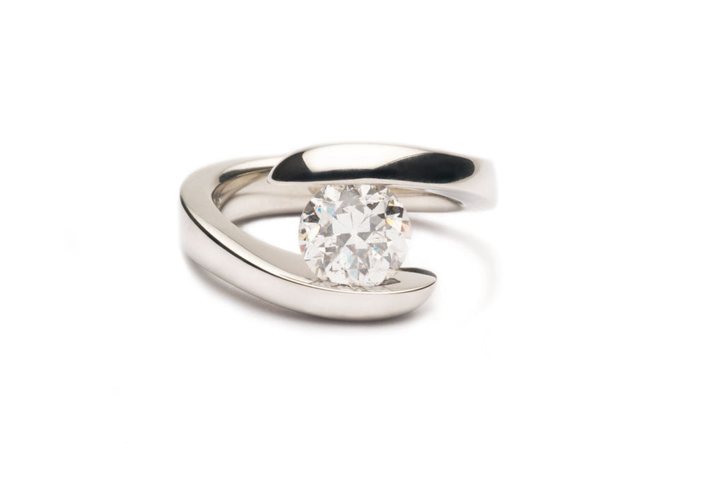 Custom-made Pressure-set Natural Diamond in the eighteen karat White Gold tension ring. Order yours Today! Price varies with the size and quality of the diamond.   $0.00