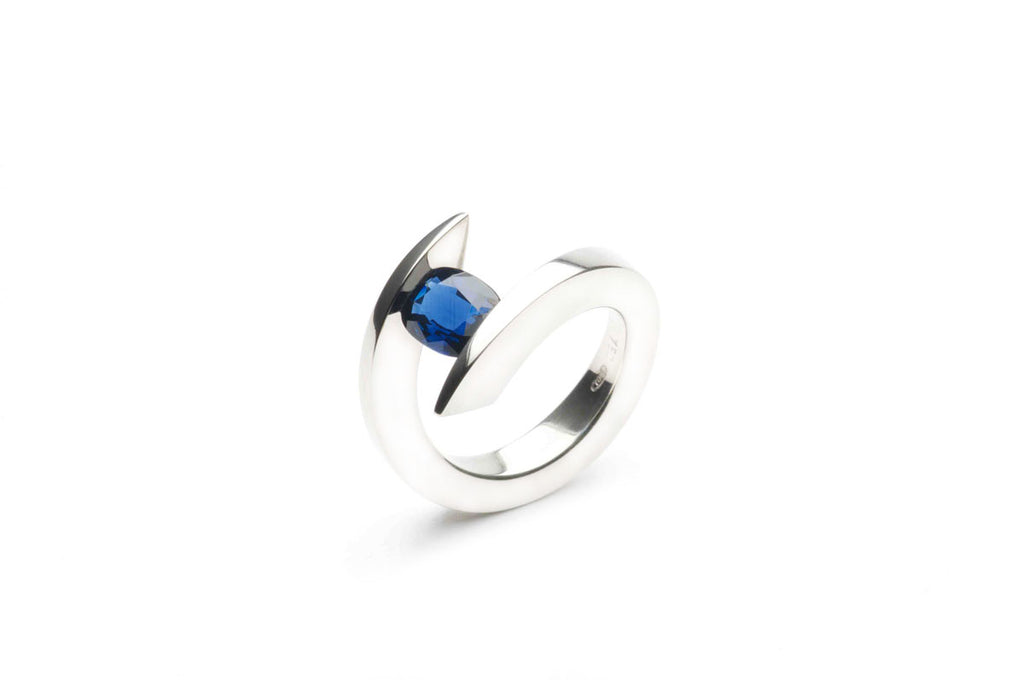 SILVERBRIDGE VIRTUOSO RING, Eighteen Karat White Gold Tension Ring holding a natural blue Sapphire nearly 2.00 ct.  Price inquiry. $0.00