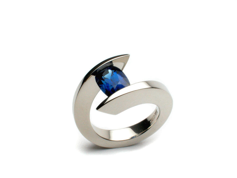 Superb natural blue Sapphire 2.06 ct. tension-set in the eighteen karat white gold.  $5,880.00