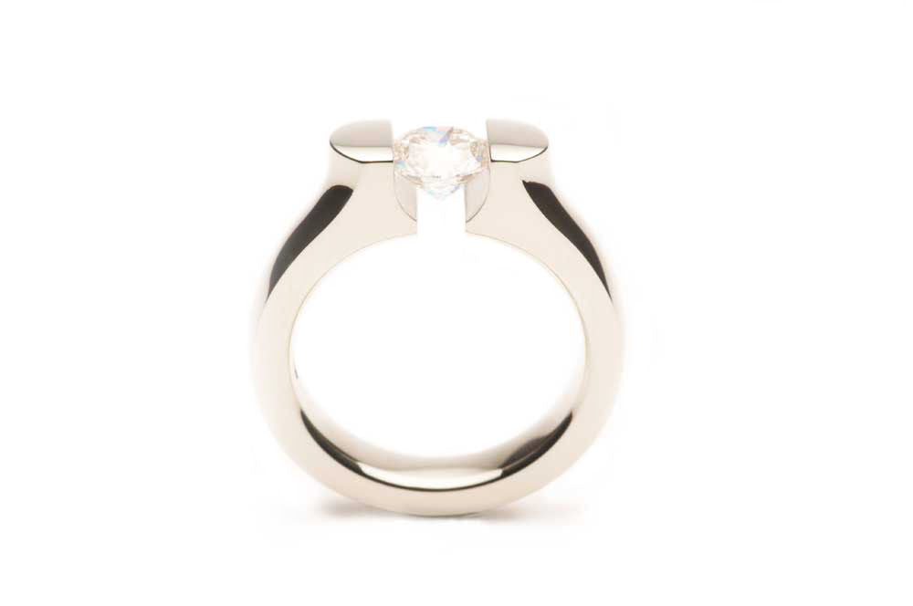 Eighteen karat White Gold ring with a pressure-set Diamond, made to order. $0.00
