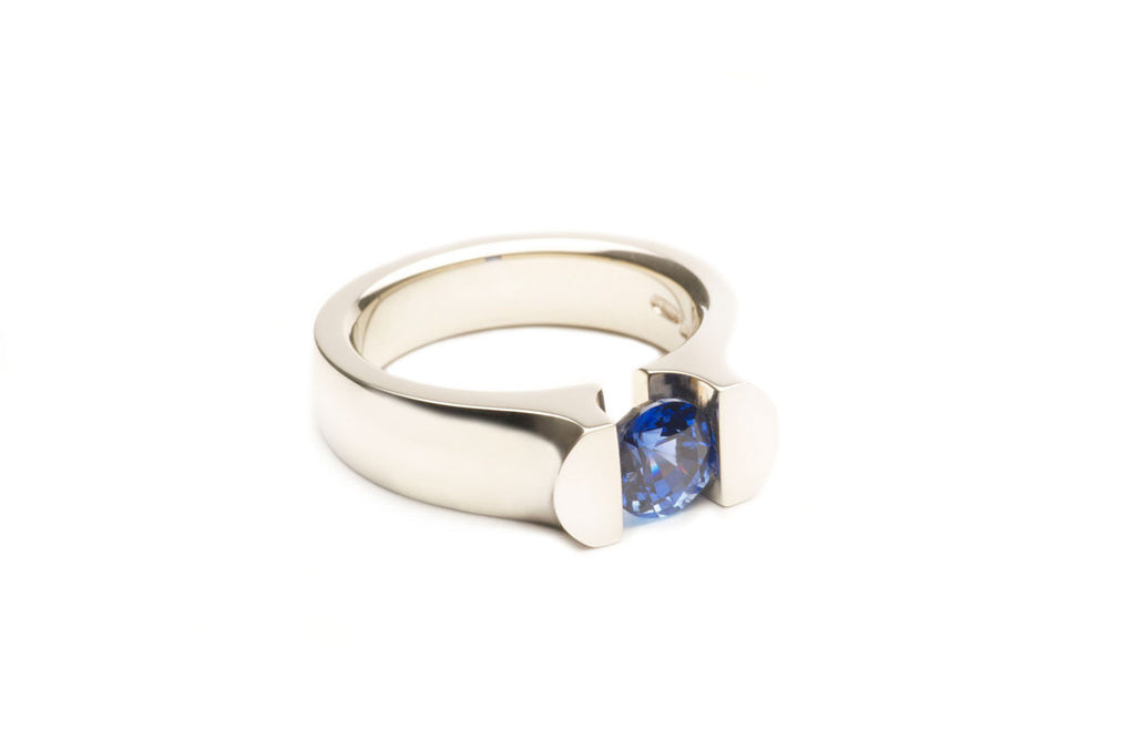 Tension Ring, eighteen karat white gold with a Blue Sapphire. Price inquiry.  $0.00